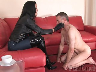 Cruel mistress is whipping dude's ass and makes him lick high knee boots