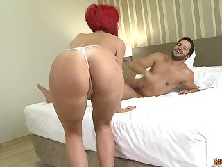 Redhead mature drops on her knees to have sex with two dudes