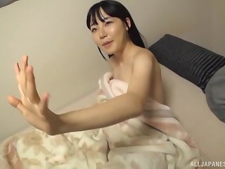 Shy Japanese brunette MILF Amami Kokoro strokes cock with her feet